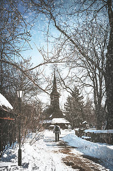 Walking though the snow at the Village Museum in Bucharest by Daniela Constantinescu