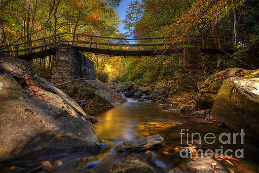 Dan Friend - Warm fall scene of stream under a bridge