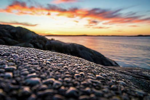 Water Drops on Rocks at the Coast by Maximilian Wollrab