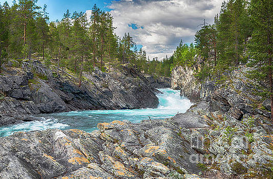 Waterfall And Rocks In Norway by Compuinfoto