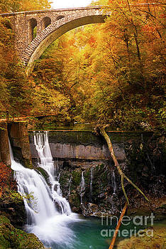 Waterfall in an autumn canyon by IPics Photography