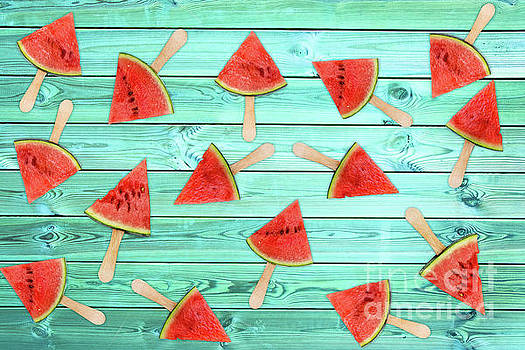 Watermelon popsicles on blue by Delphimages Photo Creations