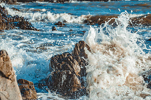 Marc Daly - Wave splashes against rock