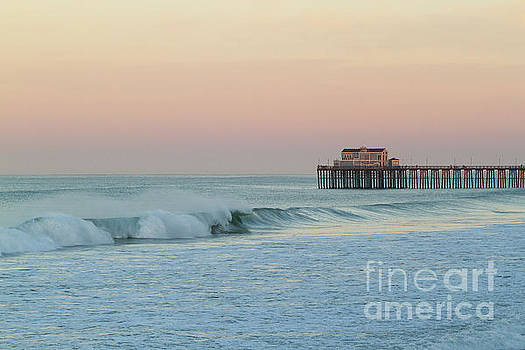 Waves and Pier at Sunrise by Denise Lilly