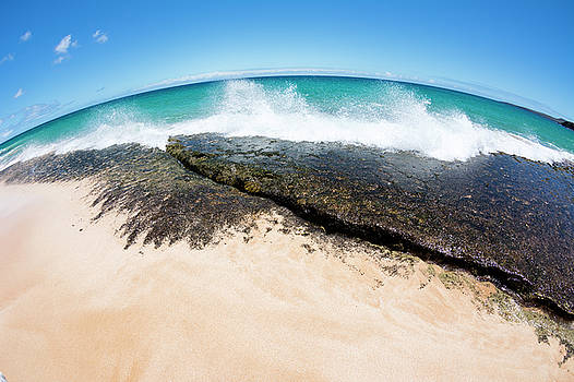 Waves crashing into reef by Joe Belanger