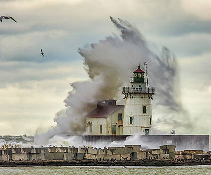 Waves over the Lighthouse in Cleveland. by Richard Kopchock