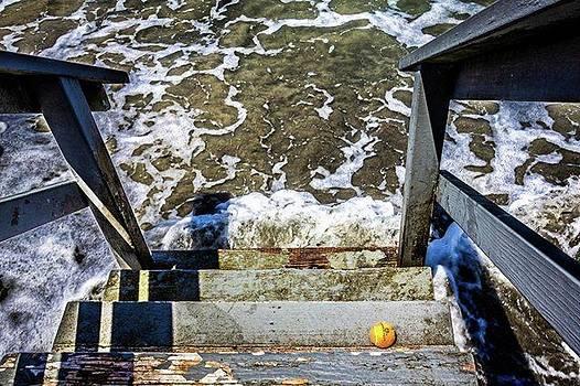 Orange Ball on Steps to Beach by Randy Bayne