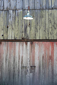 Weathered Barn with Green Light Fixture by New England Photographic