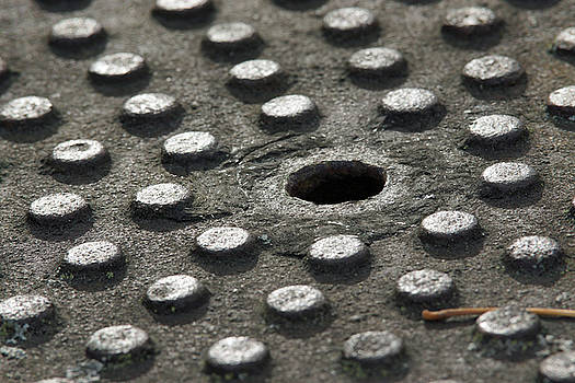 Weathered Manhole by Robin Clifton