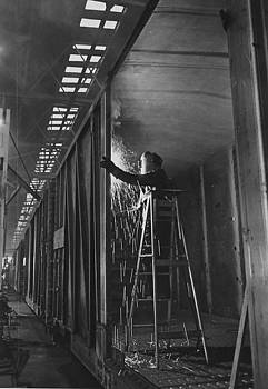 Chicago and North Western Historical Society - Welder Works on Box Car at Machine Shop