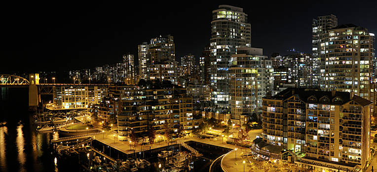 Reimar Gaertner - West End Vancouver Condominiums at night with False Creek Yacht