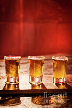 Whisky Shots In Cozy Bar Interior by Jacek Malipan