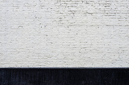 White brick wall and black skirting by Dutourdumonde Photography