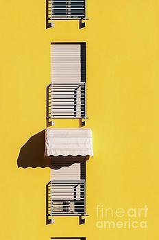 Window with sunshade by Silvia Ganora