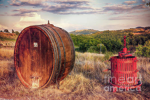 Wine Barrel and Grape Press Along a Country Road by George Oze