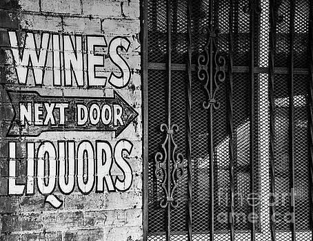 Wines Liquors Next Door by John Greco