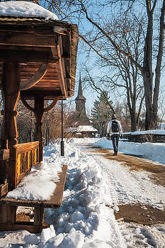 Winter walk in a snow-covered traditional Romanian Village by Daniela Constantinescu
