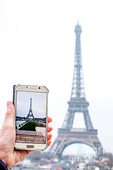 Woman anonymous photographing the Eiffel Tower. Paris. France. Europe. by Bernard Jaubert