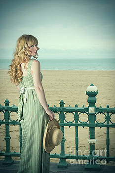 Woman By Railings At The Beach by Amanda Elwell
