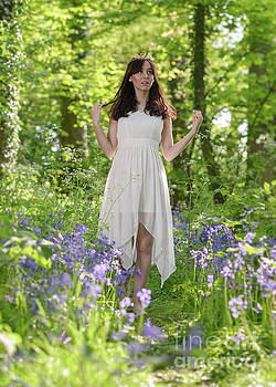 Woman In Bluebell Woodland by Amanda Elwell