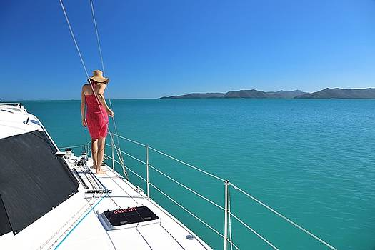 Woman on sailing boat in Whitsundays by Keiran Lusk