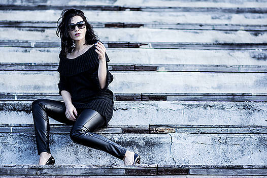 Woman on the stadium wearing black  by Newnow Photography By Vera Cepic