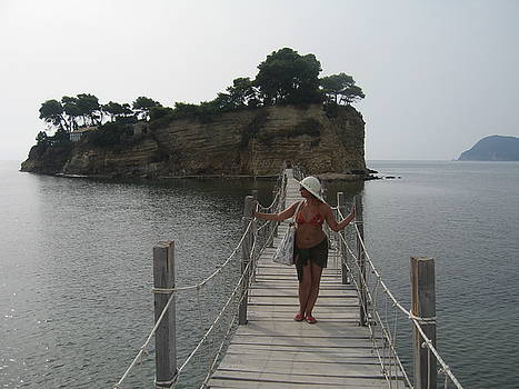 Newnow Photography By Vera Cepic - Woman on wooden bridge to the Cameo island on the island of Zaki