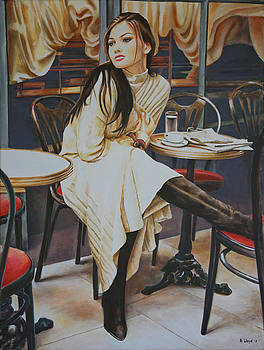 Woman sat at Cafe table by Andy Lloyd