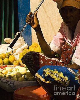 Woman selling by Robert  Suggs