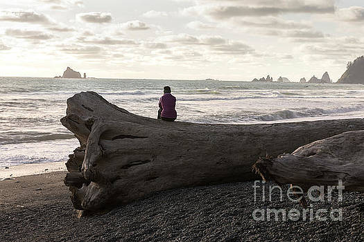 Woman Sits and Watches the Waves at Sunset at Rialto Beach in Wa by Brandon Alms