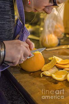 Patricia Hofmeester - Woman skinning orange