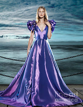 Woman wearing beautiful long blue dress at waterfront by Oleksiy Maksymenko