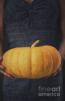 Woman with pumpkin by Mythja Photography