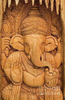 wood carving for Hindu god Ganesha on the wood. by Tosporn Preede