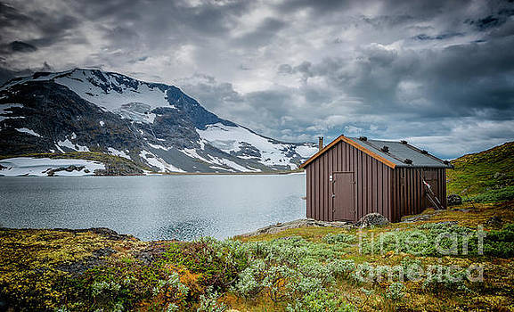 wooden houses at the famous County Road 55 norway by Compuinfoto