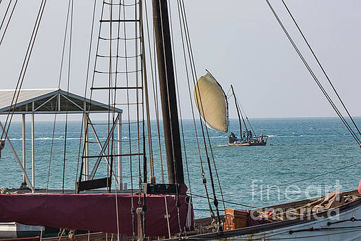 Wooden sailboat on the clear turquoise water of Zanzibar island by Mariusz Prusaczyk