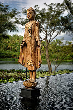 Reimar Gaertner - Wooden statue of an asian woman in traditional clothes over a po