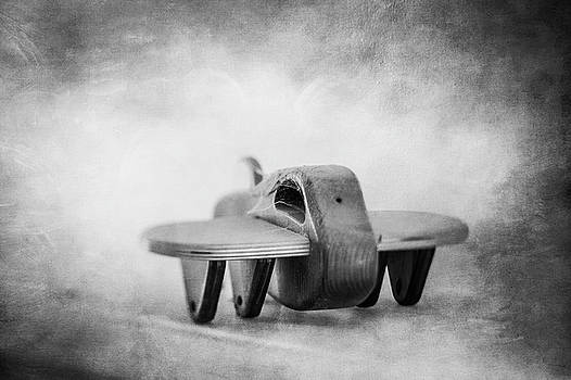 Wooden Toy Airplane on Fireplace Mantel in BW by YoPedro