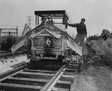 Chicago and North Western Historical Society - Track Machine Makes Way Down Line - 1957