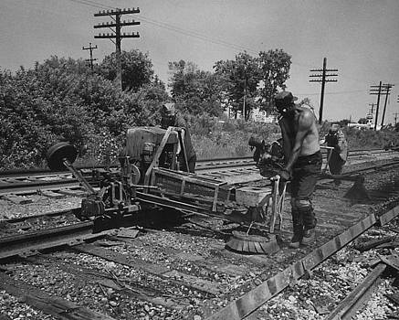 Chicago and North Western Historical Society - Workers With Track Machine in Countryside