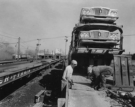 Chicago and North Western Historical Society - Working With Automobile Freight on Train - 1960