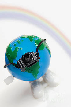 World Traveler with camera and rainbow by Linda Matlow