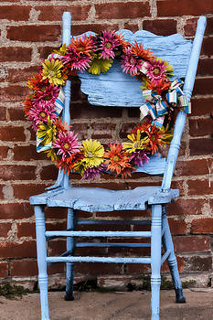 Wreath in a Chair by Joan Bertucci
