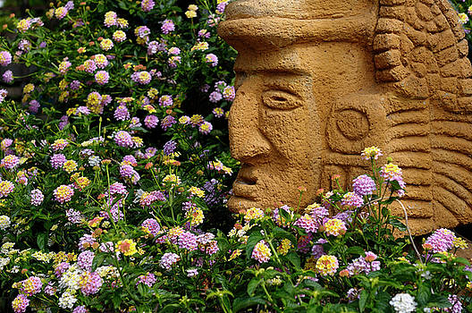 Reimar Gaertner - Xochipilli Aztec God of Flowers stone head set among flowers in
