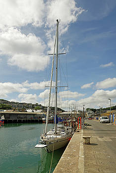 Yacht and Boats Alongside Newlyn Pier by Rod Johnson