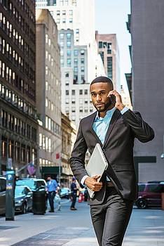 Alexander Image - Young African American businessman traveling, working in New York 17052115