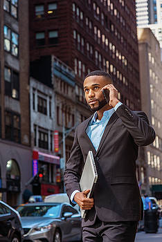 Alexander Image - Young African American businessman traveling, working in New York 17052116