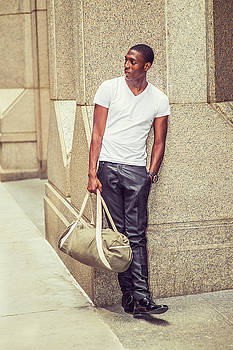 Alexander Image - Young African American Man carrying bag, traveling in New York