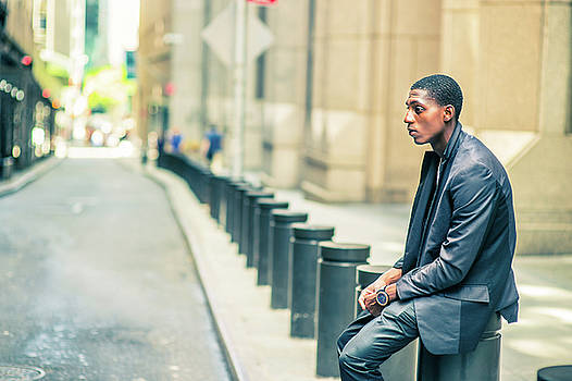 Alexander Image - Young African American Man thinking outside on street in New Yor
