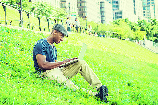 Alexander Image - Young African American Man working on laptop computer outdoor in New York 17061841